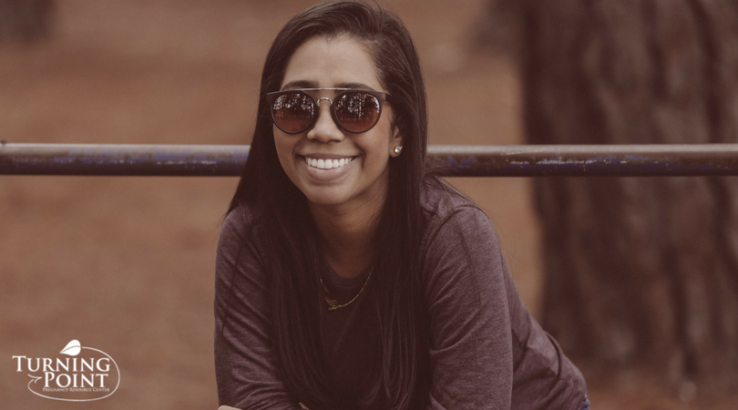 Girl Wearing Sunglasses And Brown Shirt
